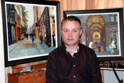 photo of artist Jim McCarthy with paintings