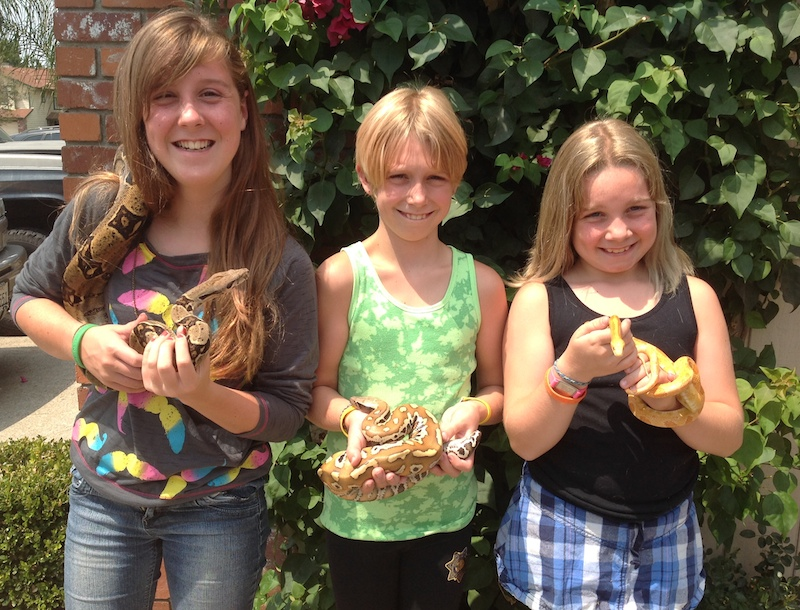 Jenna and sisters with snakes galore