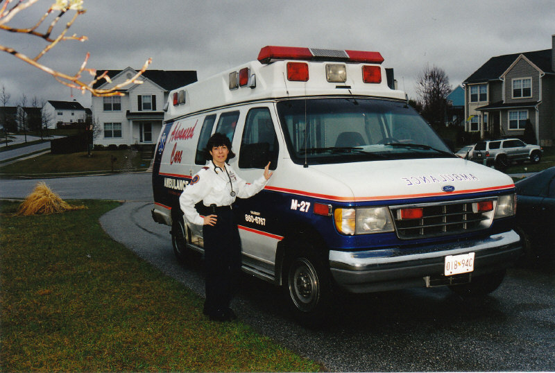 Marie Fostino standing in front of Ambulance