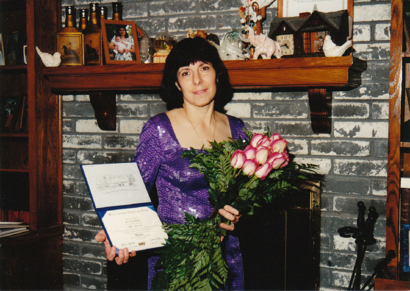 Marie Fostino with Diploma
